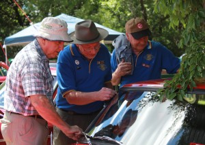 Mike pointing out some Bird Poo on the windscreen during the Concours